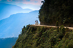 A support van for bicyclists makes its way around a hairpin turn on 'The World's Most Dangerous Road', or 'The Road Of Death', a 43 mile mountain road leading from La Paz to Coroico in the Yungas region of Bolivia.  The road, known for its extreme dropoffs, narrow widths and turns, has been responsible for many accidents.  It is now a popular tourist destination for mountain bikers.