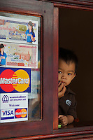 Boy at a shop Window Luang Prabang,Laos