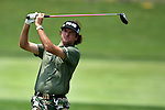 BUBBA WATSON hits his tee shot on the 9th hole at Congressional Country Club during the first round of the U.S. Open in Bethesda, MD.