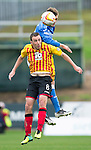 Partick Thistle v St Johnstone....25.10.14   SPFL<br /> Murray Davidson gets above Stuart Bannigan<br /> Picture by Graeme Hart.<br /> Copyright Perthshire Picture Agency<br /> Tel: 01738 623350  Mobile: 07990 594431