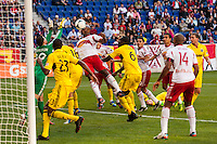 Jamison Olave (4) of the New York Red Bulls heads the ball. The New York Red Bulls and the Columbus Crew played to a 2-2 tie during a Major League Soccer (MLS) match at Red Bull Arena in Harrison, NJ, on May 26, 2013.