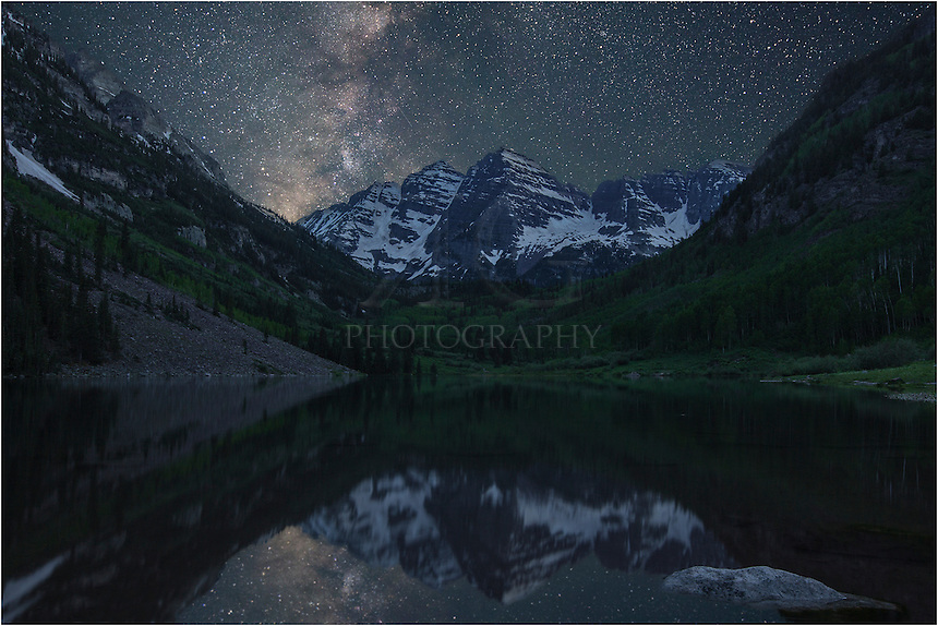 I arrived at the Maroon Bells near Aspen, Colorado, a little before 3:00am. I was hoping for a clear night in which to photograph the Milky Way as it rises over this iconic location. It took about 30 minutes to set up my astrotrac - the tracking device that allows me to photograph the stars using long exposures without producing star trails. <br /> <br /> The air was still and the skies were clear and cold. On this summer morning, I felt I could reach up and swirl my hand through the Milky Way, and I felt our small place in the universe as well. <br /> <br /> This Colorado image is one of the products of that early morning session - the Milky Way rising over the Maroon Bells with Maroon Lake in the foreground.