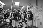 2013 May 27: The team heads back to the field during halftime of the Syracuse game. At right are the keys to defense that the team came up with the night before in a team meeting.