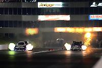 May 18, 2012; Topeka, KS, USA: NHRA funny car driver Matt Hagan (left) races alongside Bob Bode during qualifying for the Summer Nationals at Heartland Park Topeka. Mandatory Credit: Mark J. Rebilas-