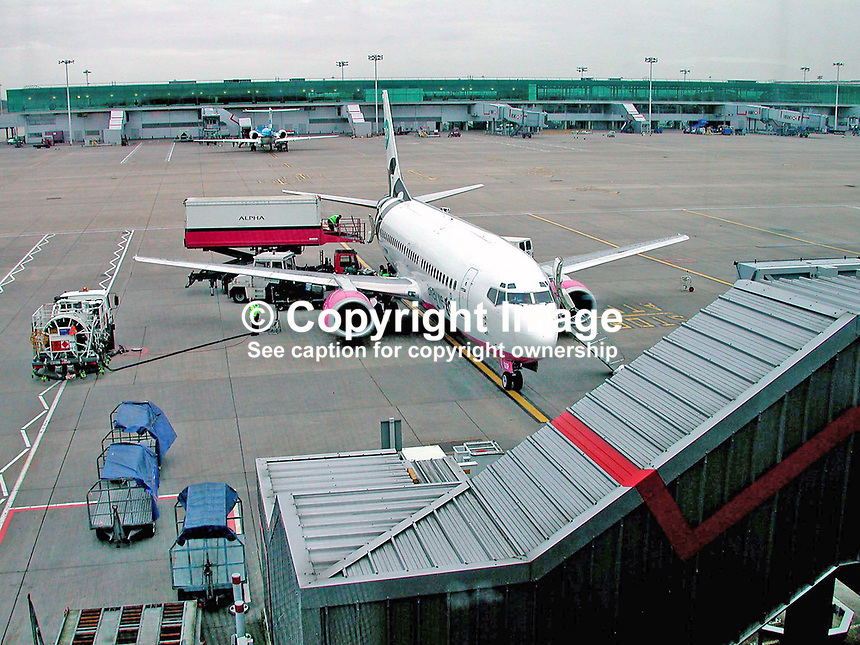 Go aircraft being refuelled and reprovisioned on the tarmac at London Stanstead Airport. Ref: 200202123290.<br /> <br /> Copyright Image from Victor Patterson, 54 Dorchester Park, <br /> Belfast, UK, BT9 6RJ<br /> <br /> t1: +44 28 9066 1296 (from Rep of Ireland 048 9066 1296)<br /> t2: +44 28 9002 2446 (from Rep of Ireland 048 9002 2446)<br /> m: +44 7802 353836<br /> <br /> e1: victorpatterson@me.com<br /> e2: victorpatterson@gmail.com<br /> www.victorpatterson.com<br /> <br /> Please see my Terms and Conditions of Use at www.victorpatterson.com. It is IMPORTANT that you familiarise yourself with them.<br /> <br /> Images used on the Internet must be visibly watermarked i.e. &copy; Victor Patterson<br /> within the body of the image and copyright metadata must not be deleted. Images <br /> used on the Internet have a size restriction of 4kbs and will be chargeable at current<br />  NUJ rates unless agreed otherwise.<br /> <br /> This image is only available for the use of the download recipient i.e. television station, newspaper, magazine, book publisher, etc, and must not be passed on to any third <br /> party. It is also downloaded on condition that each and every usage is notified within 7 days to victorpatterson@me.com<br /> <br /> The right of Victor Patterson to be identified as the author is asserted in accordance with The Copyright Designs And Patents Act (1988).