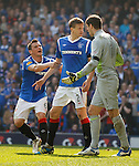 Dorin Goian would like to have a brief conversation with keeper Fraser Forster but Lee McCulloch intervenes