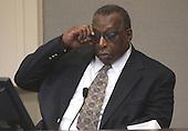 Witness Alex Jones adjusts his glasses as he testifies during the trial of sniper suspect John Allen Muhammad in courtroom 10 at the Virginia Beach Circuit Court in Virginia Beach, Virginia on October 29, 2003.  Jones was a witness in the shooting of Spotsylvania victim Caroline Seawell on October 4, 2002. <br /> Credit: Dave Ellis - Pool via CNP