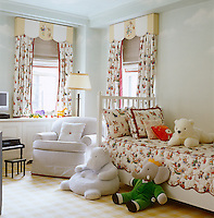 In the child's bedroom, created by family friend Leta Austin Foster, the cloud-pattern mural was painted by Pintura Studio and the bed and curtains are covered in a charming chintz with a motif of cats and dogs