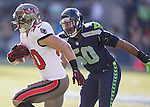 Seattle Seahawks linebacker K.J. Wright  runs down Tampa Bay Buccaneers running back Brian Leonard (30) at CenturyLink Field in Seattle, Washington on  November 3, 2013.  The Seahawks beat the Buccaneers 27-24 in overtime. ©2013. Jim Bryant. All Rights Reserved.
