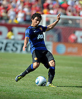 Manchester United defender Fabio da Silva (20) passes the ball.  Manchester United defeated the Chicago Fire 3-1 at Soldier Field in Chicago, IL on July 23, 2011.