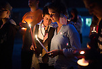 Sarah Minkin, left, and Ruth Lammers participate in a candlelight vigil at the conclusion of the Interfaith Peace Walk in Athens on Sept. 11, 2014. Photo by Lauren Pond