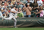 27 June 2007: Red Sox first baseman Kevin Youkilis reaches into the crowd to make the catch.   Seattle Mariners vs Boston Red Sox at Safeco Park in Seattle, Washington.