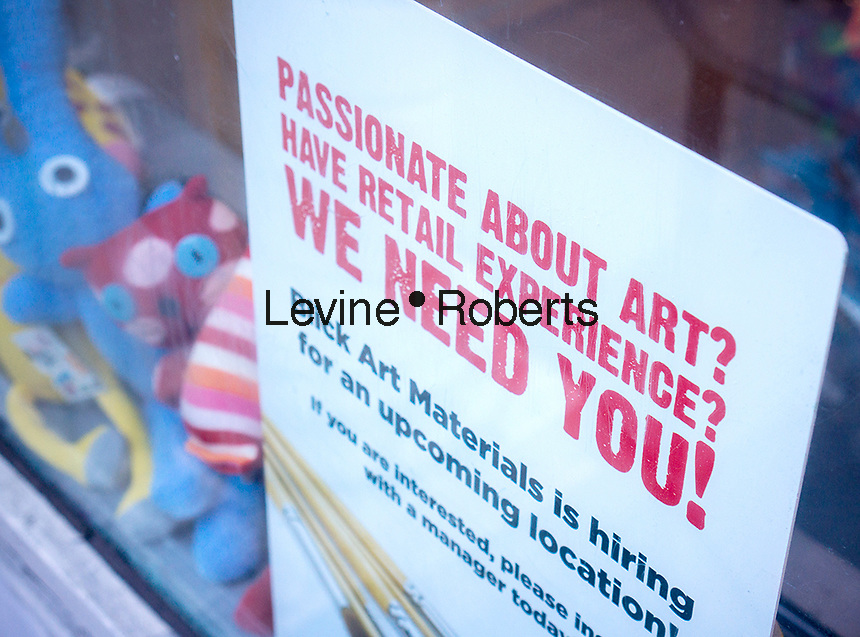 A sign outside of a Blick Art Matrials in New York on Sunday, April 7, 2013 announces that it is hiring. The Dept. of Labor recently announced that March's gain was the smallest gain in job figures in nine months with the jobless rate falling .1 percent to 7.6 percent. (© Richard B. Levine)