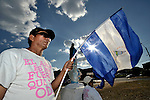 A man displays the Nicaraguan flag at an intersection in Managua as part of a protest by some 3,000 former banana workers who have been poisoned by Nemagon (dibromochloropropane). Most of the group is camped out across the street from the Nicaraguan National Assembly, where they are pressuring the government to provide health care and support their legal actions against US companies which manufactured and used the pesticide. Nemagon is considered a risk factor for cancer, kidney failure, acute respiratory disease, heart attack, sterility, muscular atrophy, skin complaints, and other health problems.