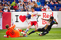 Philadelphia Union goalkeeper Zac MacMath (18) makes a stop on Sebastien Le Toux (9) of the New York Red Bulls. The New York Red Bulls defeated the Philadelphia Union 2-0 during a Major League Soccer (MLS) match at Red Bull Arena in Harrison, NJ, on July 21, 2012.