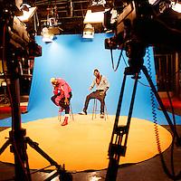 The Kuduru/Kuduro musician and TV presenter Sebem on the set of Kuduru program Sempre a Subir with Kuduru DJ Prosseguido. The program is produced by the national TV channel TPA 1.....