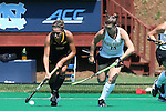 30 August 2014: Iowa's Natalie Cafone (left) and Wake Forest's Shannon Eby (CAN) (19). The Wake Forest University Demon Deacons played the University of Iowa Hawkeyes at Francis E. Henry Stadium in Chapel Hill, North Carolina as part of the ACC/Big 10 Challenge and an 2014 NCAA Division I Field Hockey match. Iowa won the game 4-1.