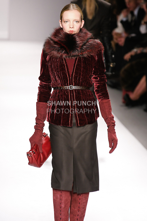 Sophie Srej walks runway in an outfit from the Elie Tahari Fall 2011 collection, during Mercedes-Benz Fashion Week Fall 2011.