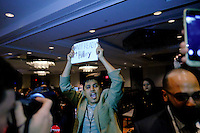 A man shouts slogans against Presidential candidate Hillary Clinton while she speaks to guests during the National Immigrant Integration Conference in Brooklyn,  New York, 12/14/2015 Photo by VIEWpress