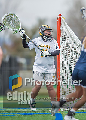 25 April 2015: University of Vermont Catamount Goalkeeper Meg Hopkins, a Senior from Penn Yan, NY, in action against the University of New Hampshire Wildcats at Virtue Field in Burlington, Vermont. The Lady Catamounts defeated the Lady Wildcats 12-10 in the final game of the season, advancing to the America East playoffs. Mandatory Credit: Ed Wolfstein Photo *** RAW (NEF) Image File Available ***