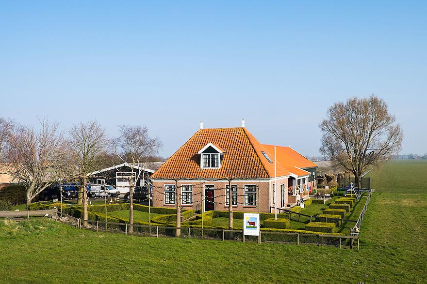 Nederland, Beemster,  17 maart 2015<br /> Boerderij in polder de Beemster. Cultureel erfgoed van de Unesco. Polder met zeer lange, kaarsrechte wegen. <br /> Foto: (c) Michiel Wijnbergh