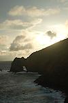 Isle San Jose; Area de Conservacion, Guanacaste Sector, Islas Murcielago (Bat Islands), view of a sea arch in the rock along the coast, sunset , Copyright © Matthew Meier, matthewmeierphoto.com All Rights Reserved