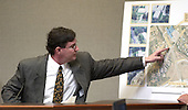 Witness Gerald Driscoll points to a map of as he testifies during the trial of sniper suspect John Allen Muhammad in courtroom 10 at the Virginia Beach Circuit Court in Virginia Beach, Virginia on October 29, 2003.  Driscoll is a Maryland chiropractor who testified that he saw John Allen Muhammad and Lee Boyd Malvo in a Chevrolet Carpice near Benjamin Trasker School in Bowie, Maryland on October 7, 2002  when student Iran Brown was shot. <br /> Credit: Dave Ellis - Pool via CNP