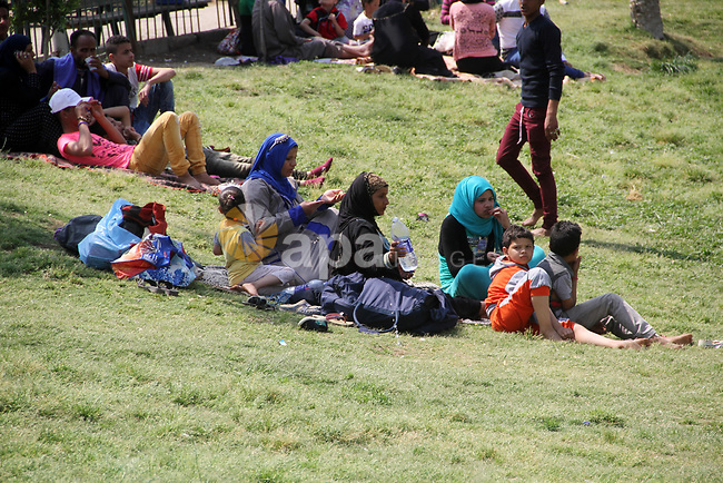 Egyptian children with their families enjoy at a garden in Cairo on April 17, 2017. Egyptians celebrate the Sham El Nessim, or the Festival of Spring Breeze, which marks the beginning of spring. Photo by Amr Sayed