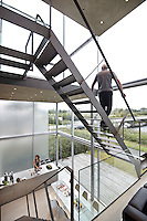 Architect Hans van Heeswijk's contemporary home in Amsterdam. Triple-height windows and virtually no walls means an uninterrupted view to the kitchen and dining area 30 feet below.