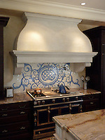 Acanthus, a hand cut jewel glass mosaic shown here in a custom kitchen backsplash using Quartz, Lapis Lazuli, Blue Spinel and Mica, is part of the Delft Collection by Sara Baldwin for New Ravenna Mosaics.