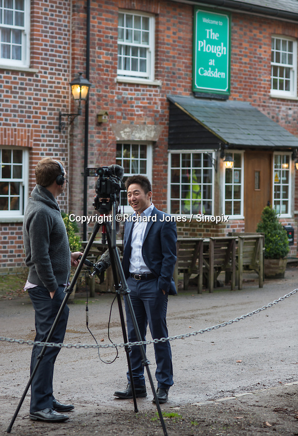 Peter Zhang, Managing Director, SinoFortone Group, is interviewed by the BBC,  outside the The Plough at Cadsden, Buckinghamshire. The group bought the pub after it was visited by Chinese Premiere Ji Jinping last year, and aim to develop  a chain of English-style pubs China.<br /> <br /> Photo by Richard Jones