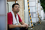 Kiyohide Mori sits on the porch of his tiny home in a temporary housing estate established for those who lost their homes during the March 11 quake and tsunami in Natori City, Miyagi Prefecture Prefecture, Japan on 08 Sept. 2011. Depsite his best efforts to secure his father's safety, Mori lost his father during the tsunami. Photograph: Robert Gilhooly