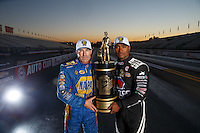 Nov 13, 2016; Pomona, CA, USA; NHRA top fuel driver Antron Brown (right) and funny car driver Ron Capps pose for a portrait with the world championship trophy following the Auto Club Finals at Auto Club Raceway at Pomona. Mandatory Credit: Mark J. Rebilas-USA TODAY Sports