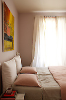Subtle tones of pink and buff create a tranquil atmosphere in the master bedroom