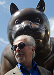 """The painter and sculptor Fernando Botero formalizes the collection of your esciltura """"El Gato"""" to the city of Medellin, which was installed in the Park Library San Cristobal. Accompanying the Mayor Anibal Gaviria (i) and his wife Sofia Vari (d). The teacher sees the cat as one of his best works. This up to the most important works that the artist has exhibited in New York, Paris, Mexico, Italy and France. The Cat is a sculpture cast in bronze using the lost wax in a private workshop located in Pietra Santa, Italy. The work weighs 1,050 pounds and measures 390x150x190 inches. In Medellín, Colombia. 02/04/2012. Photo by Fredy Amariles/VIEWpress."""