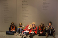 Teenage visitors to the Museum of Modern Art in New York texting after a hard afternoon of viewing art, seen on Friday, February 22, 2013. (© Richard B. Levine)