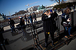 Tourists take pictures in front of the Capitol the day before the presidential inauguration, January 20, 2013 in Washington, D.C.