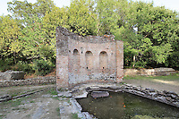 Nymphaeum of the Gymnasium, a fountain dedicated to the nymphs, Roman, 2nd century AD, Butrint, Chaonia, Albania. The Nymphaeum is a brick structure, originally plastered, with 3 niches and a quadrangular basin which was supplied with water from the aqueduct. Butrint was founded by the Greek Chaonian tribe and was a port throughout Hellenistic and Roman times, when it was known as Buthrotum. It was ruled by the Byzantines and the Venetians and finally abandoned in the Middle Ages. The ruins at Butrint were listed as a UNESCO World Heritage Site in 1992. Picture by Manuel Cohen