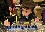 Two-year-old  BRAD SCHLECHTER, of Merrick, sets up his menorah during the Merrick Jewish Centre attempt to regain the Guinness World's Record for Most Menorot Lit in One Place at One Time that the congregation held in 2011. On the third night of Hanukkah, the 'Light Up the Night 2 - Bringing the Record Home' event also included a ceremonial candle lighting in the main sanctuary.