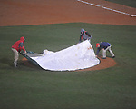 Ole Miss grounds crew and players cover the field during a rain delay in the top of the 6th inning at Oxford-University Stadium in Oxford, Miss. on Friday, March 4, 2010.  Ole Miss is leading 3-1 over Tulane thru 5 innings.