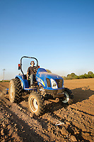 Liming the soil with New Holland tractor, in a fresh tilled field, Viridian Farms, Oregon