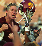 TROJAN VICTORY.Hoisted on his players' shoulders, USC head coach Pete Carroll, gives a couple of energetic fist pumps shortly after defeating the UCLA Bruins 52-21 at the Pasadena Rose Bowl, Saturday, November 23, 2002.