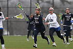 01 March 2015: Notre Dame's Grace Muller (21) and Duke's Isabelle Montagne (18). The Duke University Blue Devils hosted the University of Notre Dame Fighting Irish on the West Turf Field at the Duke Athletic Field Complex in Durham, North Carolina in a 2015 NCAA Division I Women's Lacrosse match. Duke won the game 17-3.