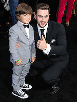 """HOLLYWOOD, LOS ANGELES, CA, USA - MAY 08: Carson Bolde, Aaron Taylor-Johnson at the Los Angeles Premiere Of Warner Bros. Pictures And Legendary Pictures' """"Godzilla"""" held at Dolby Theatre on May 8, 2014 in Hollywood, Los Angeles, California, United States. (Photo by Xavier Collin/Celebrity Monitor)"""