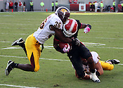 Wide reciever Tobias Palmer is stopped by Chippewa defense. NC State defeated Central Michigan 38-24 on Saturday, October 8, 2011 at Carter-Finley Stadium in Raleigh. Photo by Al Drago.