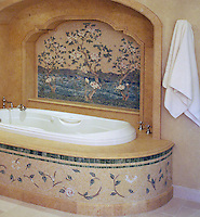 Flowering Trees, a custom hand cut natural stone mosaic backsplash and tub trim.