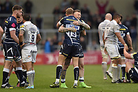 Josh Charnley of Sale Sharks hugs team-mate Mike Haley after the final whistle. Aviva Premiership match, between Sale Sharks and Bath Rugby on May 6, 2017 at the AJ Bell Stadium in Manchester, England. Photo by: Patrick Khachfe / Onside Images
