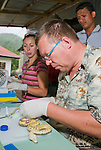 American herpetologist Hinrich Kaiser and student Caitlin Sanchez prepare specimens at their makeshift research station at Bakhita Mission, Near Eraulo, Ermera District, Timor-Leste (East Timor)