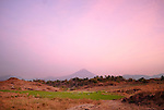 Sunset over irrigated fields in So'a Basin, central Flores. Mt. Ebulobo towers in the backdrop.