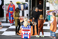 U.S. President Barack Obama and first lady Michelle Obama hand out treats during a Halloween event at the South Lawn of the White House October 31, 2016 in Washington, DC. The first couple hosted local children and children of military families for trick-or-treating at the White House.<br /> Credit: Olivier Douliery / Pool via CNP /MediaPunch